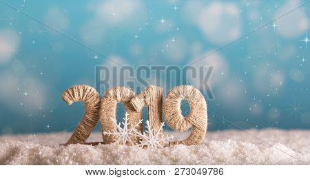 The Inscription 2019 New Year In The Snow On A Beautiful Blue Background