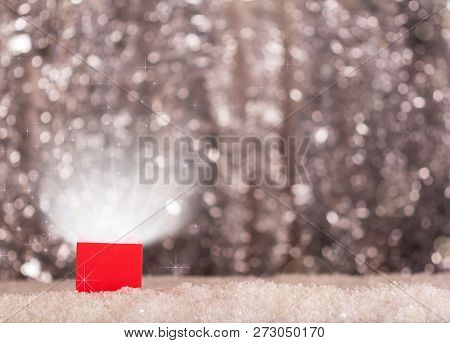 The Magic Box Is Magic In The Snow On Bright Background With Bokeh Effect