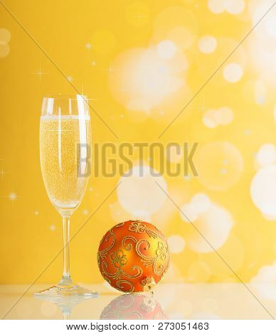 Glass Of Champagne Sparkling Christmas And A Bright Beautiful Balloon On A Yellow Background