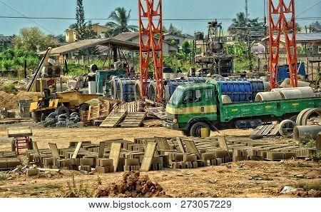 Development Of Construction Industry In West Africa. Building Materials, Machinery, Huge Pipes, Truc