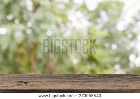 Empty Wooden Table Template Top On Nature Green Blurred Background For Montage Of Your Product On Ta