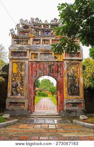 The gate to The To Mieu and Hung To Mieu Complex in the Imperial City, Hue, Vietnam poster