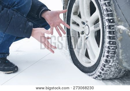 Driver Man Is Spreading His Hand And Confused By Flat Tyre Of His Car. Need A Car Air Compressor.