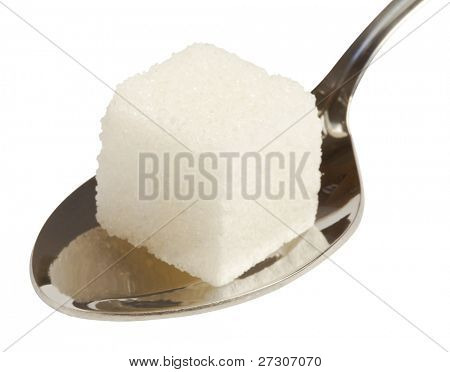 cube of white sugar on spoon,isolated on white with clipping path.