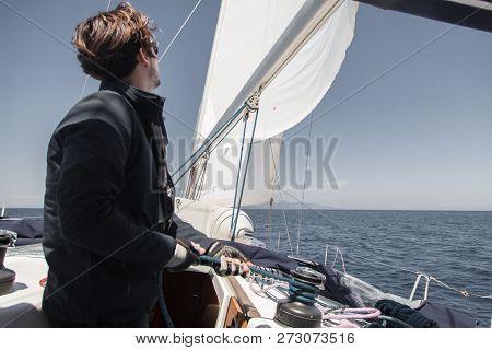 Sailor Sets Sail On A Sailing Yacht.