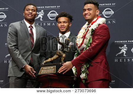 NEW YORK-DEC 8: (L-R) Ohio State Buckeyes quarterback Dwayne Haskins, Oklahoma Sooners quarterback Kyler Murray and Alabama Crimson Tide quarterback Tua Tagovailoa with the Heisman trophy in New York.