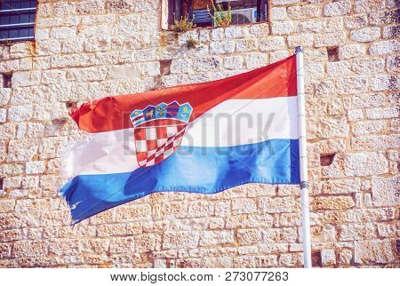 Croatian flag on stone background. Symbolic object. Red photo filter. poster