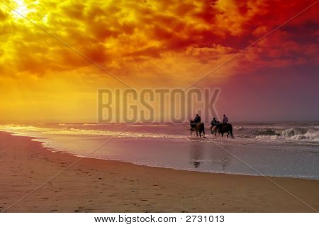 Three horse riding seniors on the beach. poster