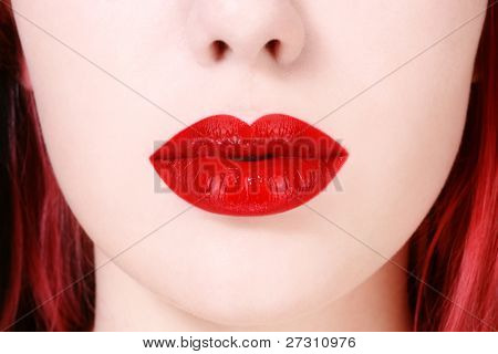 Close-up shot of beautiful full woman lips with red lipstick