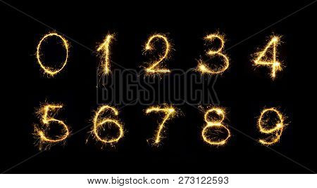 Beautiful Set Of Fireworks Numbers. Burning Sparkler Numbers Isolated On Black Background. Numbers O