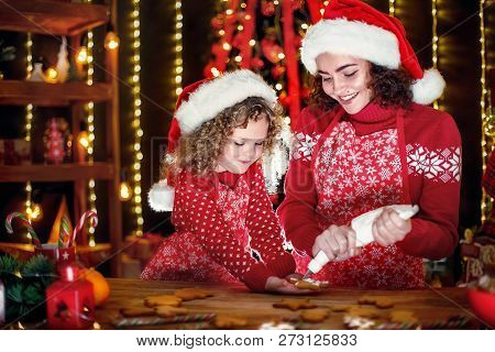 Merry Christmas And Happy Holidays. Family Preparation Holiday Food. Cheerful Cute Curly Little Girl