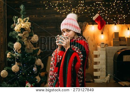 Happy Little Girl Dressed In Winter Clothing Think About Santa Near Christmas Tree. Winter Kids. Kid