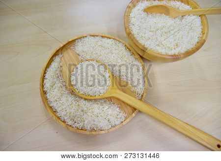 Jasmine Rice In Wooden Dish,jasmine Rice In Wooden Ladle,jasmine Rice In Wooden Bowl With Wooden Spo