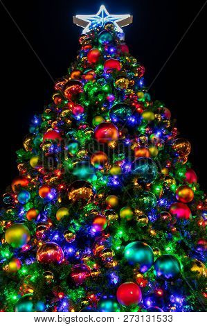 A Christmas Tree Decorated With Ornaments And Lights For The Holiday Season In El Paso, Texas.