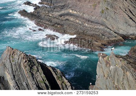 Dramatic And Colorful Cliffs On Alentejo West Coast At Cabo Sardao, Alentejo, Portugal, With White S