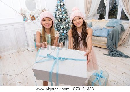 Happy Little Girls Sisters Celebrate Winter Holiday. Family Holiday. Happy New Year. Christmas Time.