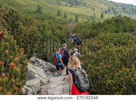 Vysoke Tatry, Slovakia - October 9, 2018: Hikers On Trail At Great Cold Valley,  Vysoke Tatry (high