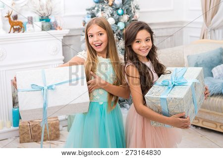 Happy Little Girls Sisters Celebrate Winter Holiday. Happy New Year. Christmas Time. Cute Little Chi