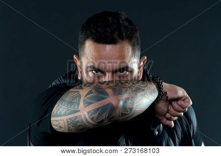 Tattooed Elbow Hide Male Face. Tattoo Culture Concept. Man Brutal Unshaven Hispanic Appearance Tatto