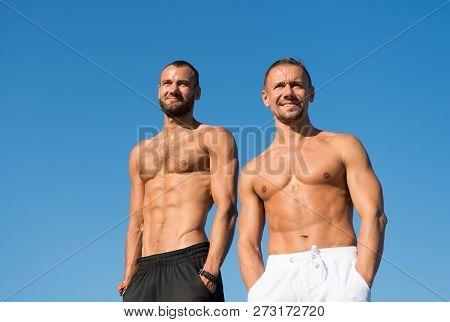 Feel Confidence. Men Sexy Muscular Torso Stand Blue Sky Background. Men Muscular Body Posing Confide