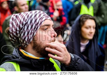 Strasbourg, France - Dec 8, 2018: Man Whistling Next To Crowd Marching In Central Strasbourg At The
