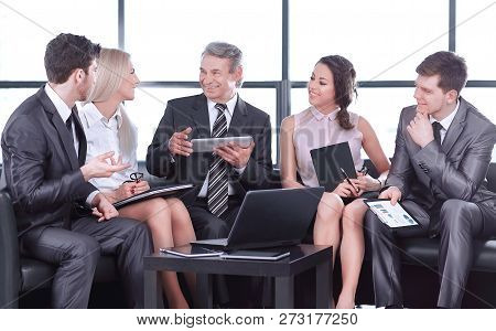 Business Partners At An Informal Meeting. The Concept Of A Successful Business
