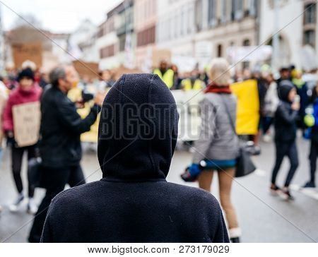 Silhouette Looking At Crowd Marching In Central Strasbourg At The Nationwide Protest Marche Pour Le