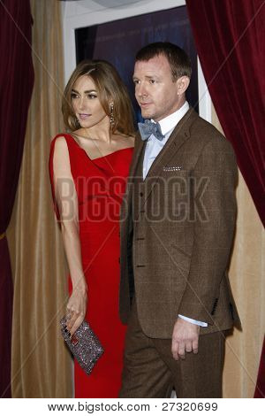 LOS ANGELES - DEC 6: Jacqui Ainsley; Guy Ritchie at the premiere of Warner Bros. Pictures' 'Sherlock Holmes: A Game Of Shadows' at the Regency Village Theater on December 6, 2011 in Los Angeles, CA