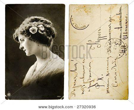 RUSSIAN EMPIRE - CIRCA 1907: A post card printed in Russian Empire shows beautiful woman portrait, circa 1907