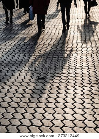 Silhouettes Of People Walking The Streets Of A Big City