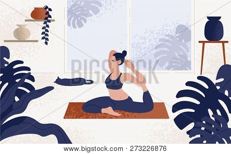 Young Woman Sitting In Yoga Posture And Meditating. Girl Performing Aerobics Exercise And Morning Me