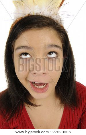A attractive young teen making a goofy face and distorted by a close up view with a wide-angle lens.
