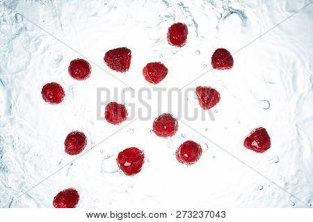 Freeze Motion Kiwi Water Splash On White Backgroundraspberries Water Splash On Whitebackground