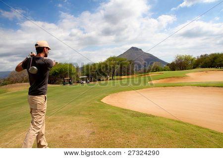 Man playing on green