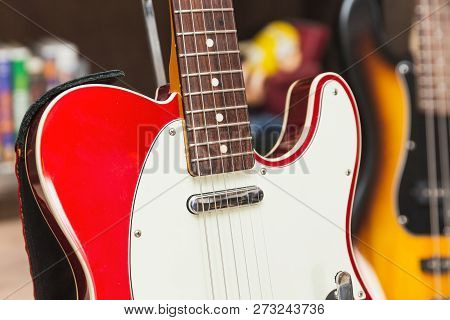 Close Up Of Neck, Body, Pickup, Strings, And Pick Guard On A Modern, Vintage, Classic Electric Guita