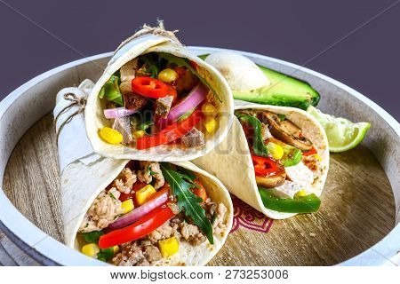Mexican Restaurant Fast Food - Wrapped Burritos With Pork Meat, Mushrooms And Vegetables Closeup At