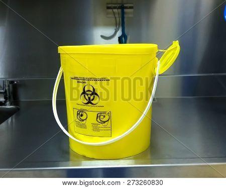 Plastic Yellow Bio Hazardous Sharp Container On Table