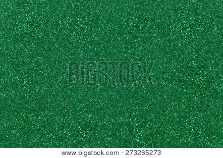 Dark Green Colored Sand Paper Textured Background With Sparkles And Glitters
