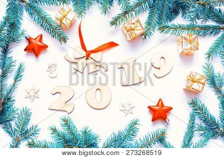 New Year 2019 background with 2019 figures, Christmas toys, green fir tree branches. Flat lay, top view - Christmas and New Year 2019 seasonal still life