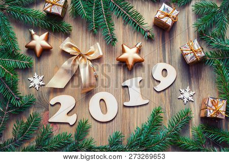 New Year 2019 background with 2019 figures, Christmas toys, green fir tree branches and snowflakes. New Year 2019 colorful festive design