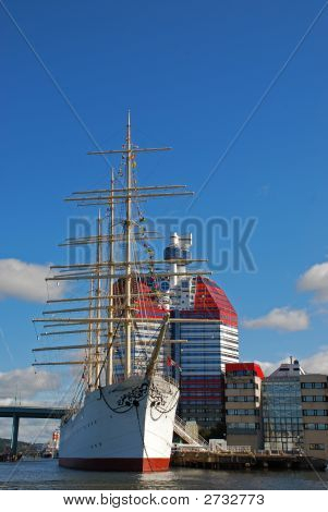 Old ship docked in Gothenburg harbor in Sweden and the city in the background. poster