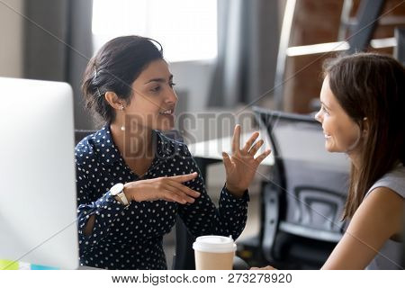 Friendly Female Colleagues Are Having Pleasant Conversation