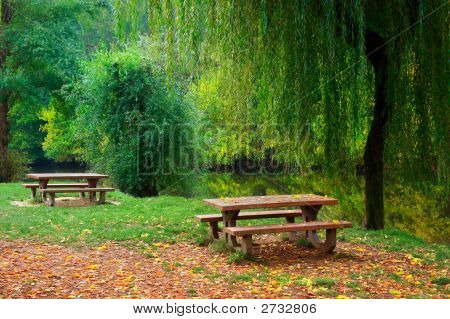 Two Picnic Tables By The River