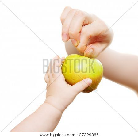 Mam and baby's hands with apple