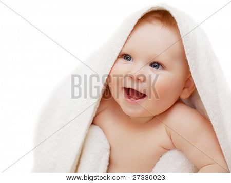 A beautiful smiling baby wrapped in quilt