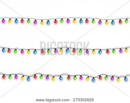 Christmas Glowing Lights On White Background. Garlands With Colored Bulbs. Xmas Holidays. Christmas