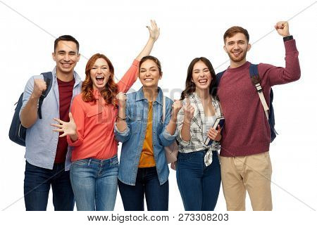 education, high school and people concept - group of happy students celebrating success over white background