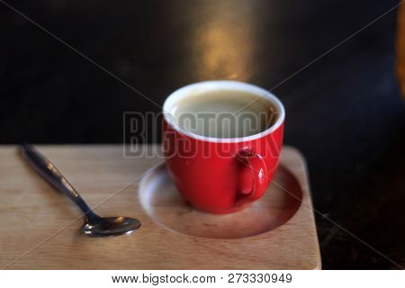 Red Cup Of Coffee On Wooden Tray