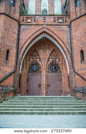 Double Lancet Doors Of The Main Entrance. Garrison Church Of Our Lady Queen Of Polish In Olsztyn, Po