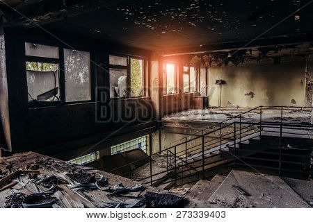 Burned Interiors After Fire In Industrial Or Office Building. Walls And Staircase In Black Soot, Fir